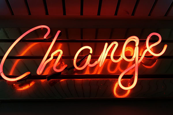 Neon light of the word Change